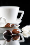 Coffee and chocolate drops Royalty Free Stock Images