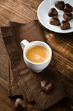 Coffee and chocolate hearts. Cup of coffee and chocolates Royalty Free Stock Image