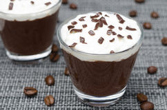 Coffee and chocolate mousse with whipped cream, horizontal Royalty Free Stock Image