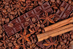 Coffee, chocolate, star anise and cinnamon sticks Royalty Free Stock Photos
