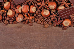 Coffee, chocolate, star anise and hazelnuts on a  wooden Stock Photos