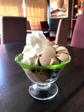 Coffee and chocolate sundae ice cream topped with whipping cream Royalty Free Stock Photos