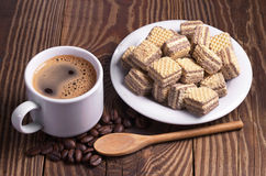 Coffee and chocolate wafers Stock Images