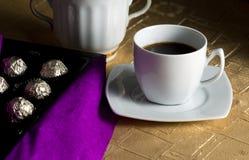 Coffee and chocolates stock photography