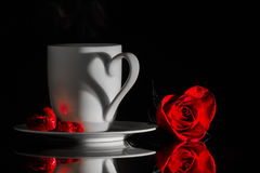 Coffee, chocolates and a velvet rose Stock Photo