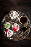 Coffee and Christmas cup cakes Stock Photo