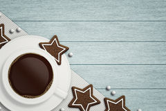 Coffee with christmas gingerbread lying on wooden table Stock Photography