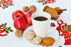 Coffee and Christmas goodies Stock Photos