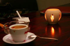 Coffee and cigarette. Coffee, cigarette and candle on table Stock Image