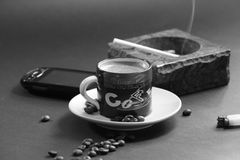 Coffee with a cigarette Stock Photos