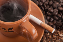Coffee and cigarette Stock Photos