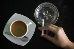 Coffee and cigarettes Stock Images