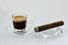 Coffee and cigars. Coffee with a cigar in front of a white background Royalty Free Stock Photography