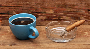 Coffee and cigars. On wood background Royalty Free Stock Image