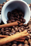 Coffee and cinnamon. Close-up coffee and cinnamon in a cup of coffee Royalty Free Stock Photo