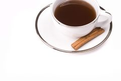 Coffee and Cinnamon. White coffee mug on white background with a stick of cinnamon Stock Photography