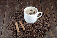 Coffee with cinnamon. anis star. Coffee cup and grains with cinnamon sticks. anis star on dark background stock images