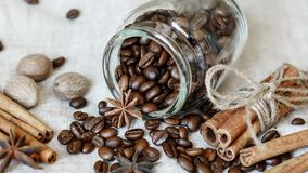 Coffee, cinnamon, anise and nutmegs Royalty Free Stock Photography