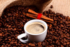 Coffee with cinnamon on coffee beans Stock Photo