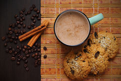 Coffee, cinnamon, cookies and coffee beans Stock Photography