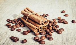 Coffee and cinnamon. Fragrant warming drink in cold winter Royalty Free Stock Photo