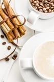 Coffee and cinnamon. Coffee with heart on foam, coffee beans and cinnamon Stock Photography