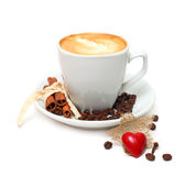 Coffee with cinnamon and red heart candy Royalty Free Stock Photo