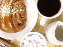 Coffee and Cinnamon Roll. Coffe, cinnamon roll, sugar and milk Stock Photos