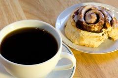 Coffee and cinnamon roll stock image