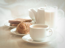 coffee and cinnamon roll, toast, milk,  for breakfast. Royalty Free Stock Images