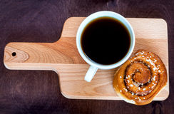 Coffee with cinnamon roll. Top view Royalty Free Stock Photos