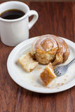 Coffee and Cinnamon Roll. Coffee and a Cinnamon Roll on a wooden table Stock Photos