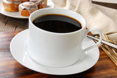 Coffee and cinnamon rolls Royalty Free Stock Photo