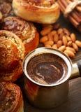 Coffee and cinnamon rolls Royalty Free Stock Image