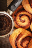 Coffee and cinnamon rolls Royalty Free Stock Photography