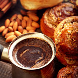 Coffee and cinnamon rolls Stock Photos