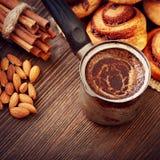 Coffee and cinnamon rolls Stock Photography