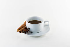 Coffee with cinnamon stick and star anise isolated on white. Stock Photo