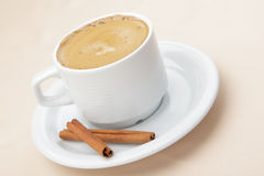Coffee and cinnamon sticks stock images