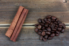 Coffee and cinnamon sticks on grunge wooden background Royalty Free Stock Images