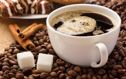 Coffee, cinnamon, sugar cubes, and sweets Stock Photos