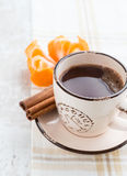 Coffee with cinnamon and tangerine. Vertical Royalty Free Stock Image
