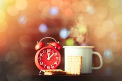 Coffee and classic alarm clock and cookie Stock Photos