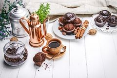 Coffee in clay cup with chocolate muffin Stock Photo