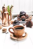 Coffee in clay cup with chocolate muffin. On white wooden board in rustic style Royalty Free Stock Photos
