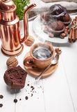 Coffee in clay cup with chocolate muffin. On white wooden board in rustic style Stock Photos