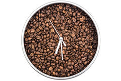 Coffee. Clock of coffee grains isolated on white background. Clock pointed at six thirty Stock Photos