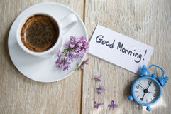 Coffee, clock and lilac Stock Image