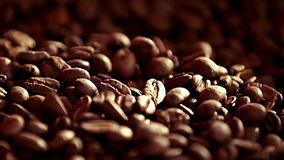 Coffee close up. Coffee. Sunshine on coffee seeds.The ready fried coffee beans. Slow mothion .Seeds of coffee fall. Dark. On this video you can see coffee beans stock video