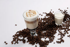 Coffee cocktail with coffee beans and milk Stock Image